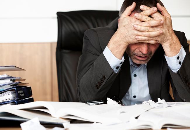 Paulistanos estão infelizes no trabalho / Crédito: iStockphoto